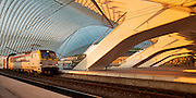 A train in the early sunlight ready to leave Li&egrave;ge Guillemins train station. <br />