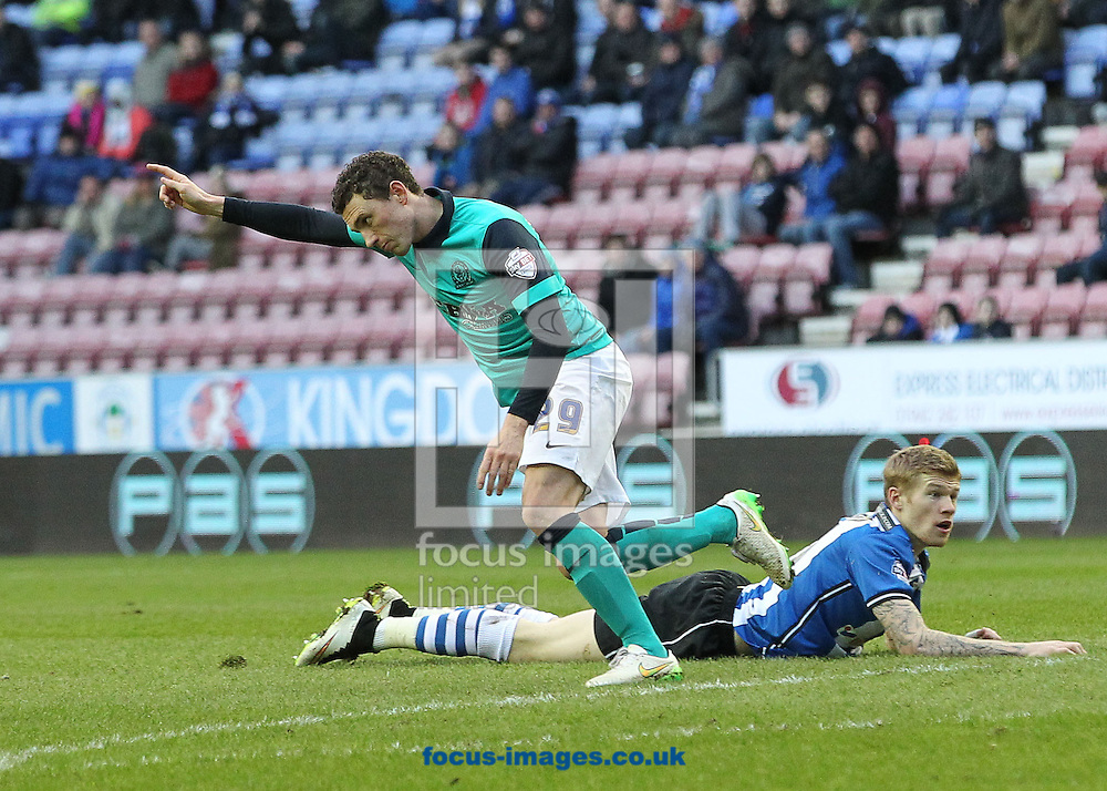Corry Evans of Blackburn Rovers celebrates scoring the first goal against Wigan Athletic during the Sky Bet Championship match at the DW Stadium, Wigan.<br /> Picture by Michael Sedgwick/Focus Images Ltd +44 7900 363072<br /> 17/01/2015