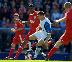 BIRKENHEAD, ENGLAND - Saturday, July 12, 2008: Tranmere Rovers's Steve Jennings and Liverpool's Damien Plessis during the first pre-season match of the 2008/2009 season at Prenton Park. (Photo by David Rawcliffe/Propaganda)