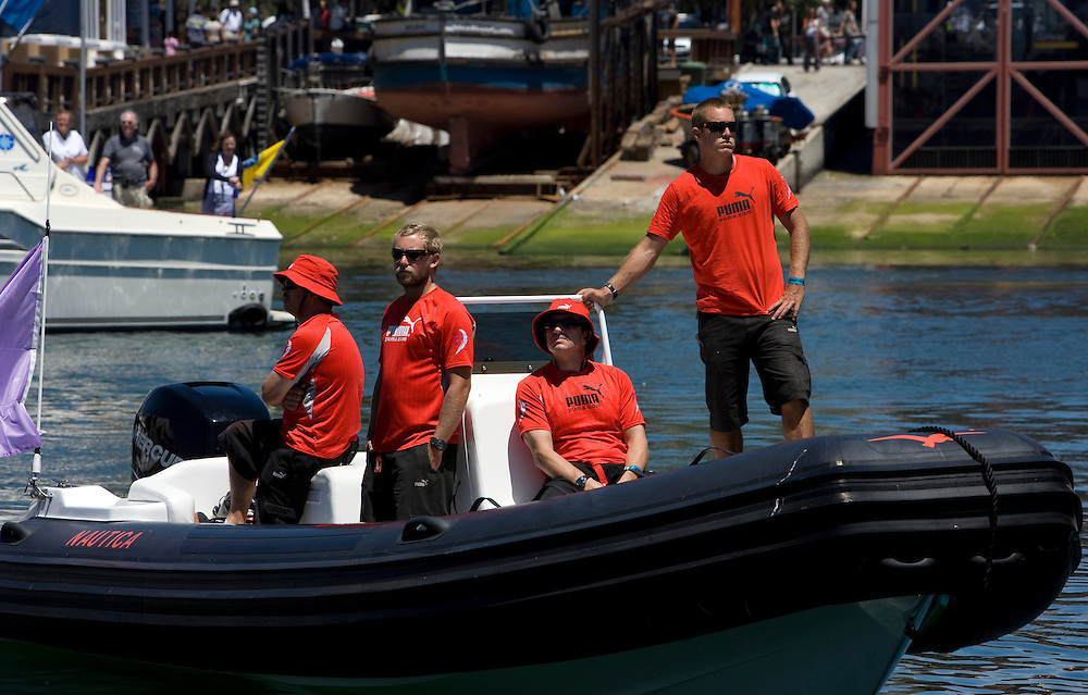 15NOV08. Members of puma's shore team wait in the RIB for Il Mostro to complete their docking out ceremony in Cape Town, for the start of Leg 2 to Kochi. From left Mark Nicora, Chris Hill, Will Oxley and Nick Dana
