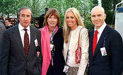 Left to right, MR & MRS JACKIE STEWART, he is the former World champion racing driver and <br /> their son and daughter in law  MR & MRS PAUL STEWART, at the Chelsea Flower show in London on 22nd May 2000.<br /> OEJ 87