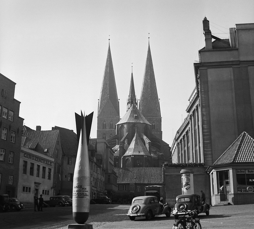 A Bomb-Shaped Sculpture Warns of Possible Future Air Raids in Front of the Marienkirche, Lübeck, 1937