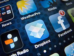 detail of iPhone 4G screen showing Dropbox cloud storage app