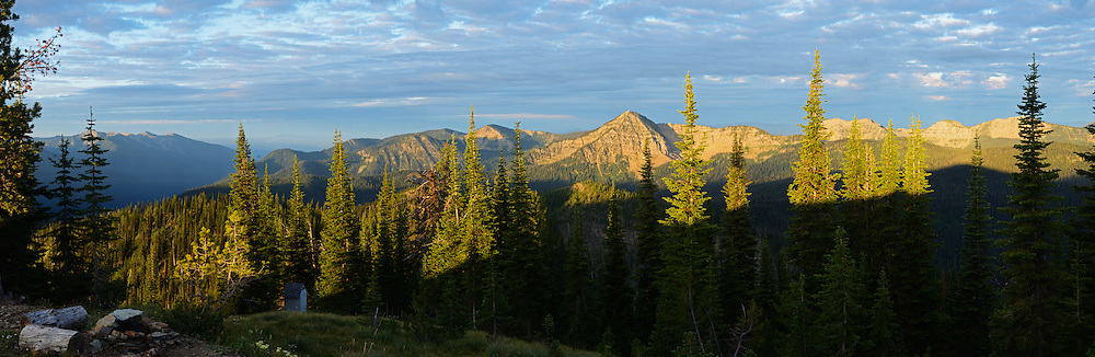Panoramic view of the Whitefish Range with Stahl Peak in the background from Mount Wam, a forest service backcountry rental lookout cabin site in the Ten Lakes Proposed Wilderness Area. Kootenai National Forest north of Eureka, northwest Montana.