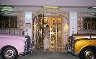 """Hong Kong. Kai Bong and Brenda Chau in front of their house """"villa de Oro"""" with their famous gold and pink Rolls Royce. Hong KOng   /  Kai Bong et brenda Chau devant leur maison, la villa de oro"""", décorée couleur or avec leurs Rolls Royce dorée et rose/   /  4    L3371  /  R00225  /  P0006073"""