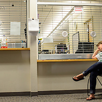 060314  Adron Gardner/Independent<br /> <br /> Stacey Guerrero rests while waiting for election results into the night at the McKinley County Courthouse in Gallup Wednesday.