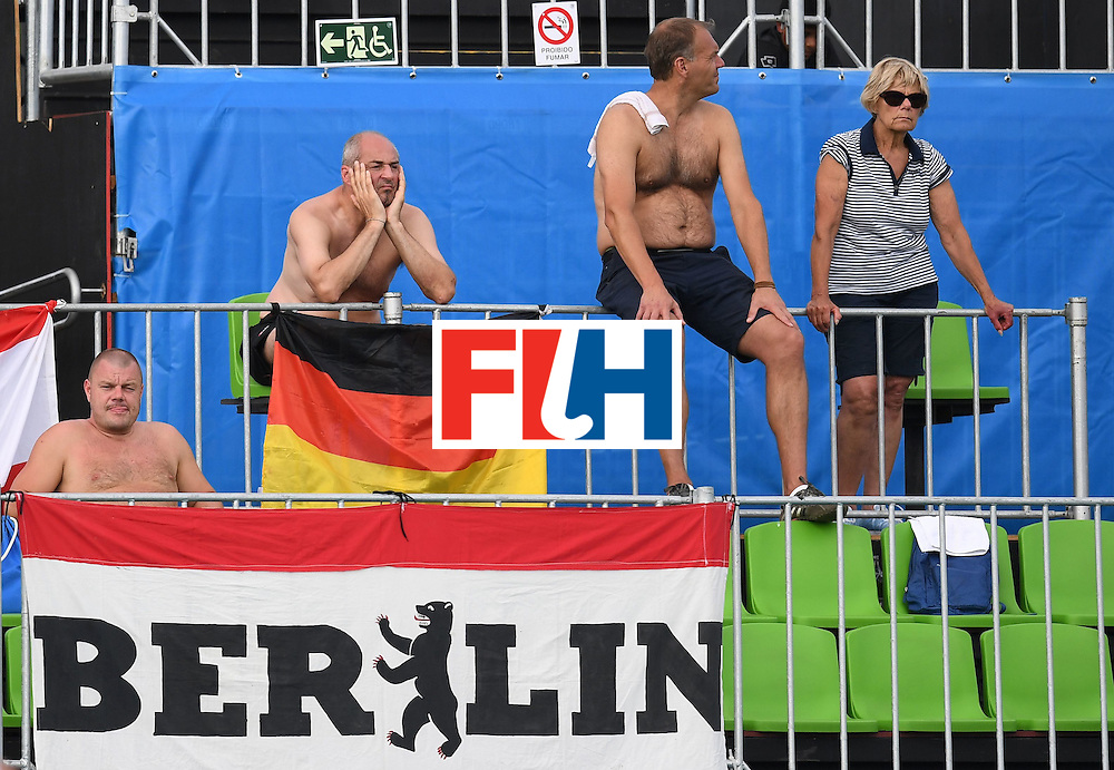 Germany fans watch the women's field hockey New Zealand vs Germany match of the Rio 2016 Olympics Games at the Olympic Hockey Centre in Rio de Janeiro on August, 8 2016. / AFP / MANAN VATSYAYANA        (Photo credit should read MANAN VATSYAYANA/AFP/Getty Images)