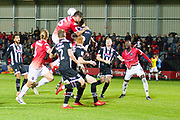 Salford City defender Cameron Burgess in areal challenge with Grimsby Town defender Luke Waterfall during the EFL Sky Bet League 2 match between Salford City and Grimsby Town FC at Moor Lane, Salford, United Kingdom on 17 September 2019.