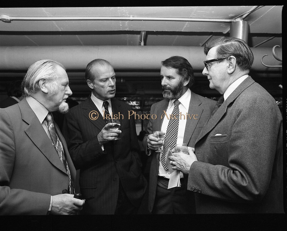 """20/06/1979.06/20/1979.20th June 1979.An exhibition of photographs presented by the Norwegian Foreign Ministry as a gift to the Department of Architecture, Bolton Street, Dublin entitled """"New Architecture from Norway"""" opened at the Kilkenny Design Shop, Nassau Street. Photograph shows (from left) Mr Oscar Richardson, President of the Royal Institute of the Architects of Ireland; Mr Julian Kulski, a Polish Architect, educated in Ireland, and now on a mission from the World Bank in Washington; Mr Padraig Murphy, former President, R.I.A.I.; and Mr Kevin Fox, former President, R.I.A.I. and Head of Division of Architecture and Planning in College of Technology, Bolton Street, Dublin chatting at the exhibitions opening."""
