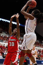 March 21, 2011; Stanford, CA, USA; Stanford Cardinal forward Nnemkadi Ogwumike (right) shoots over St. John's Red Storm forward Centhya Hart (30) during the first half of the second round of the 2011 NCAA women's basketball tournament at Maples Pavilion.