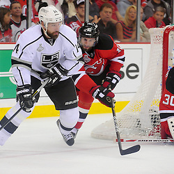 May 30, 2012: Los Angeles Kings right wing Justin Williams (14) controls the puck away from New Jersey Devils defenseman Peter Harrold (10) during second period action in game 1 of the NHL Stanley Cup Final between the New Jersey Devils and the Los Angeles Kings at the Prudential Center in Newark, N.J.