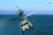 MH-60R and SH-60B perform a scissor break over the Pacific Ocean
