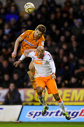 Wolves Forward Kevin Doyle (IRL) and Blackpool Defender Alex John-Baptiste (ENG) compete in the air during the second half of the match - Photo mandatory by-line: Rogan Thomson/JMP - Tel: Mobile: 07966 386802 26/01/2013 - SPORT - FOOTBALL - Molineux Stadium - Wolverhampton. Wolverhampton Wonderers v Blackpool - npower Championship.