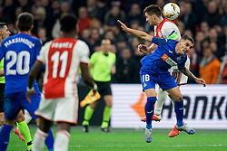 Dusan Tadic #10 of Ajax and Mauro Arambarri #18 of Getafe in action during the Europa League match R32 second leg between Ajax and Getafe at Johan Cruyff Arena on February 27, 2020 in Amsterdam, Netherlands