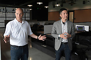 Apr 4, 2018; Los Angeles, CA, USA; AECOM Hunt construction leader Ryan Collett (left) and Gensler Sports design director Steve Chung speak at the grand opening of the LAFC Performance Center on the campus of Cal State LA. The 30,000 square foot and $30 million facility will serve as home of the LAFC players, staff, coaches and academy.