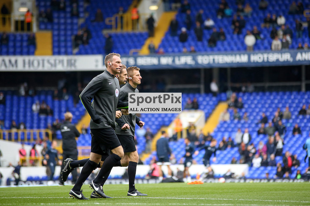 The Match Offiicials warm up before Tottenham Hotspur vs Liverpool on Saturday 17th of October 2015.