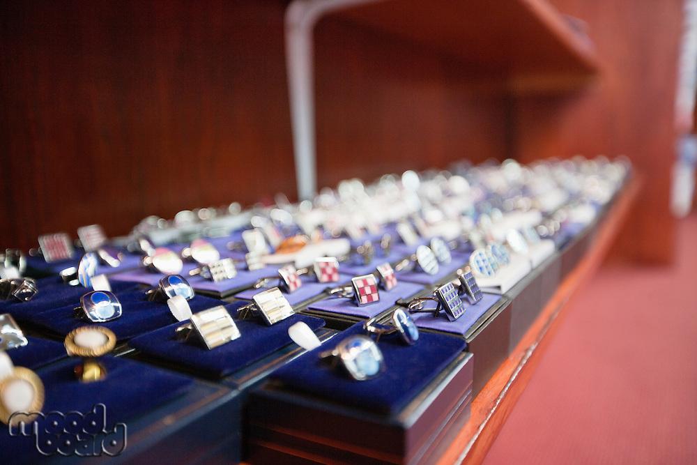 Set of hand cufflinks on display