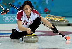 12-02-2014 CURLING: OLYMPIC GAMES: SOTSJI<br /> Japan verslaat Rusland met 8-4. Ekaterina Galkina<br /> ©2014-FotoHoogendoorn.nl