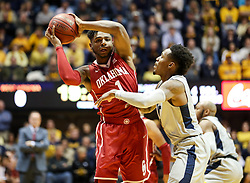 Jan 6, 2018; Morgantown, WV, USA; Oklahoma Sooners guard Rashard Odomes (1) looks to pass the ball while guarded by West Virginia Mountaineers guard Daxter Miles Jr. (4) during the first half at WVU Coliseum. Mandatory Credit: Ben Queen-USA TODAY Sports