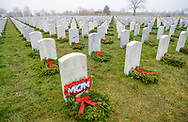 Gravesites are seen after wreaths were placed on top during Wreaths Across America Saturday, December 14, 2019 at Washington Crossing National Cemetery in Newtown, Pennsylvania. Thousands of wreaths are laid each year for Wreaths Across America by volunteers who gather and then place the wreaths at graves of veterans. (Photo by William Thomas Cain / CAIN IMAGES)