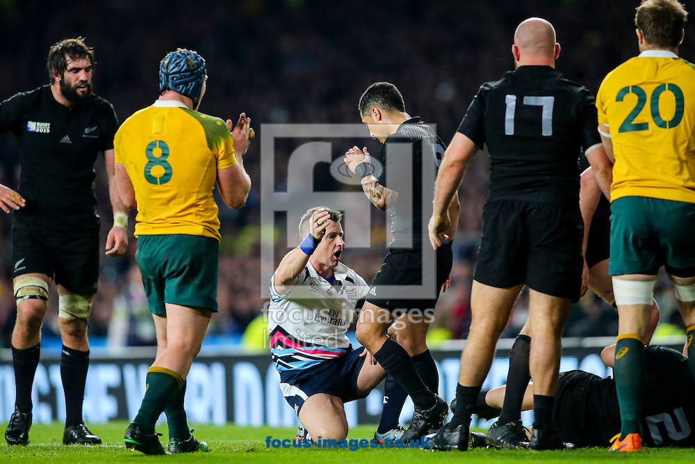 Referee Nigel Owens (centre) gets close to the action during the final of the 2015 Rugby World Cup at Twickenham Stadium, Twickenham<br /> Picture by Andy Kearns/Focus Images Ltd 0781 864 4264<br /> 31/10/2015