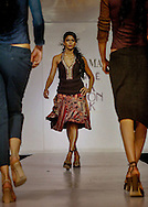 A model displays a creation by Indian designer Ritu Kumar during the Lakme India Fashion Week in New Delhi, India, Wednesday, April 20, 2005. (AP Photo/Sebastian John)