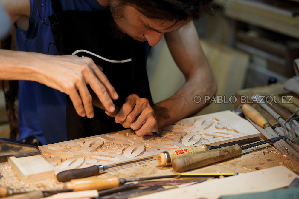 10/08/2016. Luthier Mario Unsain works on an organistrum in a workshop on August 10, 2016 in Pelayos de la Presa, Madrid province, Spain. The Collegiate of Santa María la Mayor is a Romanesque architecture church built during the 12th and 13th centuries. Recents restorations of the Church discovered many details on its sculptures, and luthiers found the opportunity of recovering and to reproduce instruments showing on its North gate. (© Pablo Blazquez)