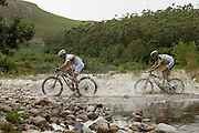 Nino Schurter (front) and Philip Buys of Team SCOTT-Odlo MTB keep their lead as they pass through Greyton during stage 4 of the 2014 Absa Cape Epic Mountain Bike stage race from The Oaks Estate in Greyton, South Africa on the 27 March 2014<br /> <br /> Photo by Greg Beadle/Cape Epic/SPORTZPICS