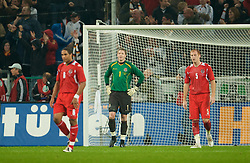 MONCHENGLADBACH, GERMANY - Wednesday, October 15, 2008: Wales' James Collins and goalkeeper Wayne Hennessey look dejected after conceding a goal to Germany during the 2010 FIFA World Cup South Africa Qualifying Group 4 match at the Borussia-Park Stadium. (Photo by David Rawcliffe/Propaganda)