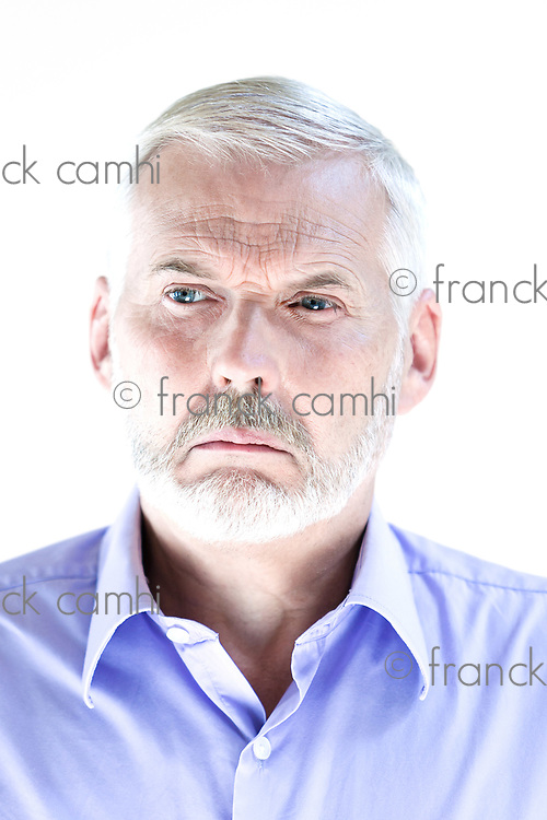 caucasian senior man portrait pucker displeased isolated studio on white background
