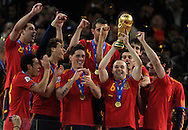 Spain's footballer Andres Iniesta (3rd-R) holds up the trophy, next his teammates, after winning the 2010 World Cup South Africa football after defeating by 1-0 to Netherlands in the final match, at Soccer City stadium, in Johannesburgo, South Africa, on July 11, 2010.   (Alejandro Pagni/PHOTOXPHOTO).