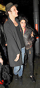28.MAY.2007. LONDON<br /> <br /> A WORSE FOR WEAR LOOKING AMY WINEHOUSE LEAVING THE SHEPHERDS BUSH EMPIRE WITH HUSBAND BLAKE AFTER HER GIG. A FAN GOT A BIT TO CLOSE AND BLAKE LOST IT AND STARTED PUSHING THE GUY BEFORE HAVING TO HOLD AMY UP AS SHE WAS STUMBLING DOWN THE STREET.<br /> <br /> BYLINE: EDBIMAGEARCHIVE.CO.UK<br /> <br /> *THIS IMAGE IS STRICTLY FOR UK NEWSPAPERS AND MAGAZINES ONLY*<br /> *FOR WORLD WIDE SALES AND WEB USE PLEASE CONTACT EDBIMAGEARCHIVE - 0208 954 5968*