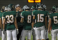 Kennedy head coach Tim Lewis talks with his team during their game at Kingston Stadium in Cedar Rapids on Friday, September 27, 2013.