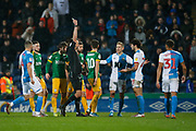 Tempers fray as /Referee James Linington shows a yellow card to to Lewis Travis of Blackburn Rovers   during the EFL Sky Bet Championship match between Blackburn Rovers and Preston North End at Ewood Park, Blackburn, England on 11 January 2020.