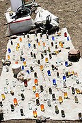 Africa, Tanzania, Frontier Market selling medication The goods are placed on a blanket on the ground