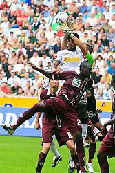 10.09.2011,  BorussiaPark, Mönchengladbach, GER, 1.FBL, Borussia Mönchengladbach vs 1. FC Kaiserslautern, im Bild.Kevin Trapp (Kaiserslautern #29)  (R) gegen Dante (Mönchengladbach #31) und Rodnei (Kaiserslautern #20)..// during the 1.FBL, Borussia Mönchengladbach vs 1. FC Kaiserslautern on 2011/09/09, BorussiaPark, Mönchengladbach, Germany. EXPA Pictures © 2011, PhotoCredit: EXPA/ nph/  Mueller *** Local Caption ***       ****** out of GER / CRO  / BEL ******