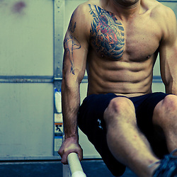 Andrew Balha does an L-site while training for Winter WOD Fest, Crossfit image, picture, photo, photography of health, elite, exercise, training, workouts, WODs, taken at Progressive Fitness CrossFit,Colorado Springs, Colorado, USA.