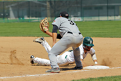 17 April 2016:  Adam Glogovsky dives safely back to first avoiding a tag by Nick Sotiros during an NCAA division 3 College Conference of Illinois and Wisconsin (CCIW) Pay in Baseball game during the Conference Championship series between the North Central Cardinals and the Illinois Wesleyan Titans at Jack Horenberger Stadium, Bloomington IL