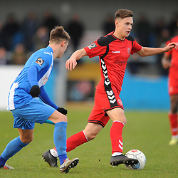 TELFORD COPYRIGHT MIKE SHERIDAN 1/1/2019 - Ryan Barnett of AFC Telford takes on Reece Leek during the Vanarama Conference North fixture between AFC Telford United and Nuneaton Borough FC.