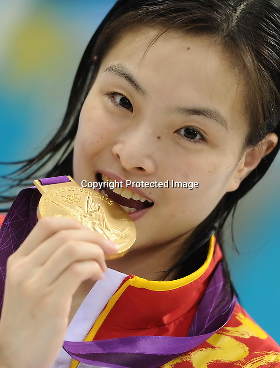 Aug 05, 2012; London, ENGLAND; Gold medallist Wu Minxia of China celebrates on the podium in the medal ceremony for the Women's 3m Springboard Diving final on Day 9 of the London 2012 Olympic Games at the Aquatics Centre.