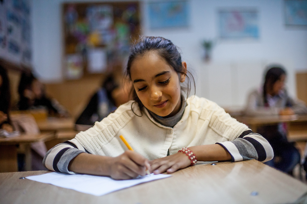 12 years old Roma girl Georgiana during class at the school in Marginenii de Jos, where pupils - Roma and Non Roma - are educated together. The village has about 3400 inhabitants. The majority population are Roma with 2700 citizens and 700 non Roma.