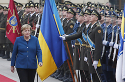 November 1, 2018 - Kiev, Ukraine - German Chancellor ANGELA MERKEL (L) with Ukrainian President PETRO POROSHENKO (not pictured) look on the Guard of Honor during their meeting in Kiev, Ukraine, on 1 November 2018. German Chancellor Angela Merkel travelled to the Ukrainian capital Kiev for talks the situation at eastern Ukraine, and about the Crimea, annexed by Russia. And also for discuss the strengthening of trade and economic and investment cooperation between Germany and Ukraine. (Credit Image: © Serg Glovny/ZUMA Wire)