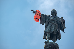 "July 4, 2018 - Barcelona, Catalonia, Spain - As a result of the arrival in Barcelona of the Opem Arms, members of the organization have hung a life jacket on the arm of the conquistador at the Christopher Columbus monument in Barcelona. Following the arrival in Barcelona of the rescue vessel Open Arms, Ã""scar Camps, leader of ProActiva Open Arms accompanied by the Mayor of Barcelona, Ada Colau and several MEPs, attended the press in a press conference. (Credit Image: © Paco Freire/SOPA Images via ZUMA Wire)"
