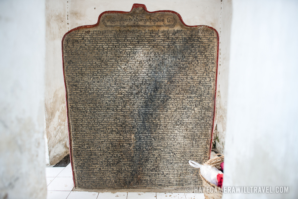 "A ""page"" of the World's Largest Book. Built by King Mindon in 1857 at the foot of Mandalay Hill, Kuthodaw Pagoda houses what is known as The World's Largest Book, which consists of 729 kyauksa gu or stone-inscription caves, each containing a marble slab inscribed on both sides with a page of text from the Tipitaka, the entire Pali Canon of Theravada Buddhism."