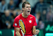 Jerzy Janowicz of Poland reacts after winning ball in the first single match during first day of the BNP Paribas Davis Cup 2013 between Poland and South Africa at MOSiR Hall in Zielona Gora on April 05, 2013...Poland, Zielona Gora, April 05, 2013..Picture also available in RAW (NEF) or TIFF format on special request...For editorial use only. Any commercial or promotional use requires permission...Photo by © Adam Nurkiewicz / Mediasport