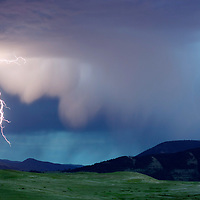 A rare May electrical storm knifes down at the foot of the Rattlesnake Wilderness near Missoula, Montana.