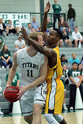 21 February 2017:  Colin Bonnett looks for someone to pass off to after getting pinned deep in the lane by Chrishawn Orange during an College men's division 3 CCIW basketball game between the Augustana Vikings and the Illinois Wesleyan Titans in Shirk Center, Bloomington IL