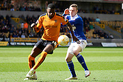 Ipswich Town striker Freddie Sears and Wolverhampton Wanderers defender Dominic Iorfa contest the ball during the Sky Bet Championship match between Wolverhampton Wanderers and Ipswich Town at Molineux, Wolverhampton, England on 2 April 2016. Photo by Alan Franklin.
