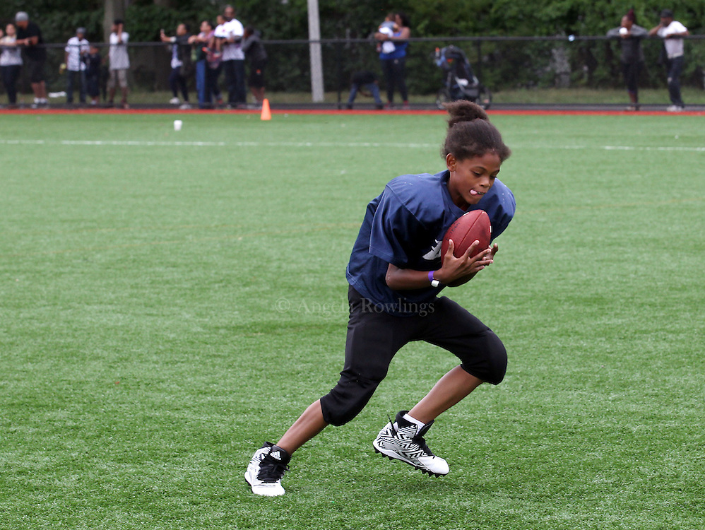 (Boston, MA -- 8/23/15)  Jaylin Lugo-Davis, 10, of the Dorchester Eagles, catches a pass from Gov. Charlie Baker during the Boston Mayor's Cup at Roberts Playground in Dorchester, Sunday, August 23, 2015. Staff photo by Angela Rowlings