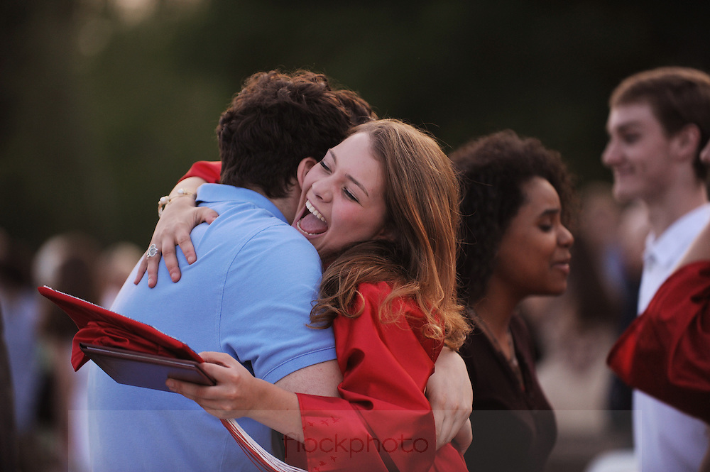 Charlotte Willauer gets a hug after graduating from Wellesley High School, June 3, 2016.<br /> Wicked Local staff photo / Kate Flock